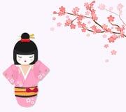 Gullig japansk docka med filialen för körsbärsrött träd Royaltyfri Fotografi