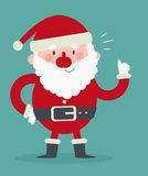 Gullig jultomten med tummar upp Arkivfoto