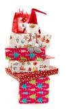 Gullig leksak på en bunt av julaskar Fotografering för Bildbyråer
