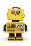 Gullig leksakrobot som ner ser Arkivbild