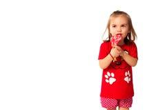 Gullig liten flicka med en klubba Royaltyfria Foton