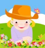 Gullig liten flicka på lawnen Royaltyfria Bilder