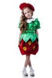 Gullig liten flicka som poserar i jordgubbedräkt arkivbild