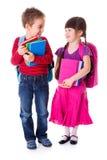 Gullig liten skolflicka och skolpojke Fotografering för Bildbyråer