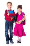 Gullig liten skolflicka och skolpojke Royaltyfria Foton