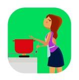 Gullig matlagning för ung kvinna Royaltyfri Fotografi