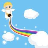 Gullig ängel i himlen med regnbågen Arkivfoton
