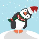 Gullig pingvin med julhatten Arkivbilder