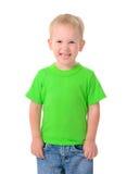 Gullig pojke i grön skjorta arkivbild