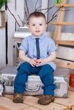 Gullig pojke i jeansdräkt Fotografering för Bildbyråer
