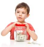 Gullig pojke med dollar Fotografering för Bildbyråer