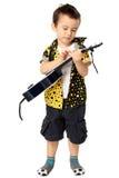 Gullig pojke med gitarren Royaltyfria Foton