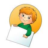 Gullig pojke som rymmer ett tecken på vit Fotografering för Bildbyråer