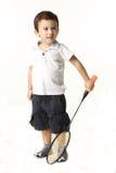 Gullig pojke som spelar batminton Royaltyfri Foto