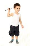Gullig pojke som spelar batminton Fotografering för Bildbyråer