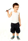 Gullig pojke som spelar batminton Arkivfoto