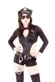 Gullig poliskvinna som poserar med solglasögon royaltyfria bilder