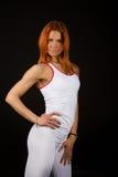 gullig posera sexig sportswoman Royaltyfri Fotografi