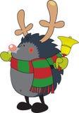 Gullig seende igelkott som kläs som Rudolph renen Arkivbild