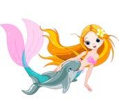 Gullig sjöjungfru och delfin Arkivbilder