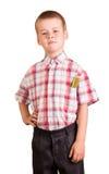 Gullig skolpojke med blyertspennor som isoleras på vit bakgrund Arkivbilder