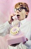 gullig skvallra nerdtelefon royaltyfri foto