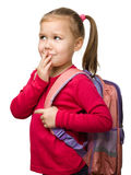 gullig ståendeschoolgirl för ryggsäck fotografering för bildbyråer