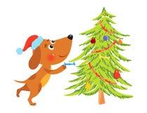 Gullig tecknad filmhund som dekorerar julträdet Arkivbilder