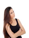 Gullig tonåringflicka med långt hår som ser upp Royaltyfri Foto