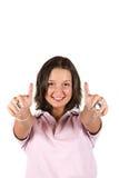 Gullig tonåringflicka med thumbs-up Arkivfoto
