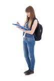 Gullig tonårs- flicka med anteckningsboken som isoleras på vit royaltyfria foton