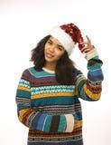Gullig ung flicka i den isolerade santas röda hatten Arkivfoto