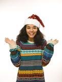 Gullig ung flicka i den isolerade santas röda hatten Royaltyfria Foton