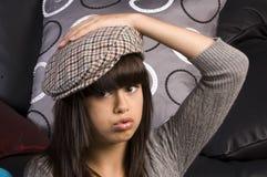 Gullig ung flicka med hatten arkivfoton