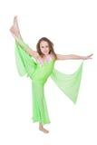 Gullig ung flicka som gör gymnastik Royaltyfria Foton