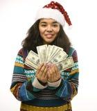 Gullig ung verklig afrikansk flicka i santas den röda hatten Arkivfoto
