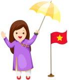 Gullig vietnamesisk flicka i traditionell klänning Arkivbild