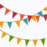 Gulliga festliga färgrika flaggor Fotografering för Bildbyråer