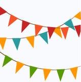 Gulliga festliga färgrika flaggor Arkivbilder