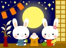 Gulliga kaniner på den Tsukimi festivalen Arkivbild