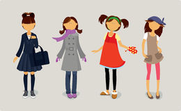 gulliga klänningar fyra stilfulla flickor Arkivbild