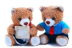 Gulliga nallebjörnar med kortet Arkivbild