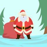 Gulliga Santa Claus med en påse som är full av gåvor Arkivbild