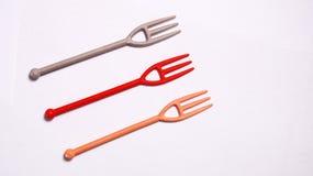 Gulliga små plast-gafflar Arkivbild