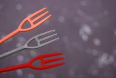 Gulliga små plast-gafflar Royaltyfri Foto