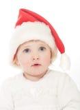 Gulligt behandla som ett barn flickan i Santas hatt Royaltyfria Foton
