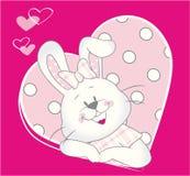 Gulligt behandla som ett barn kaninflickan i rosa hjärta Arkivfoton