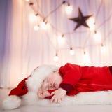 Gulligt behandla som ett barn santa att sova Arkivfoton