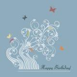 gulligt blom- lyckligt för födelsedagkort Arkivfoto