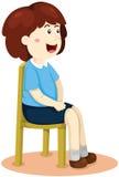 Gulligt flickasammanträde på stolen Arkivfoto